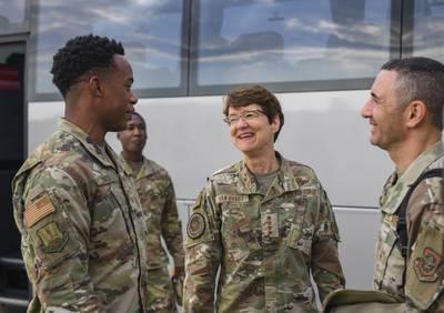 U.S. Air Force Gen. Jacqueline Van Ovost, Air Mobility Command boss, and Chief Master Sgt. Brian Kruzelnick, AMC Command Chief, share a laugh with Staff Sgt. Christopher Lynch from the 521st Air Mobility Operations Wing at Ramstein Air Base, Germany, Sept. 9, 2021. AMC is responsible for providing rapid global mobility in support of national security requirements, including the recent airlift of more than 124,000 evacuees from Afghanistan, many who were processed by the 521st AMOW and Ramstein's 86th Airlift Wing during Operation Allies Refuge. (Senior Airman Kiaundra Miller/Air Force)