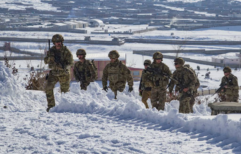 U.S. soldiers hike up a snow-covered hill to take part in a key leader engagement Jan. 16, 2020, in southeastern Afghanistan.