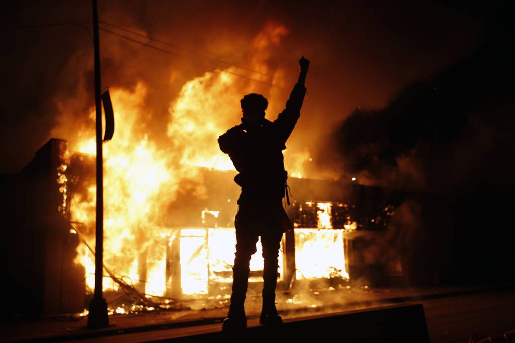A check-cashing business burns Friday, May 29, 2020, in Minneapolis. Protests continued following the death of George Floyd, who died after being restrained by Minneapolis police officers on Memorial Day.