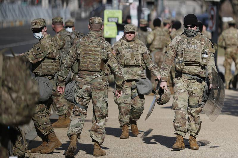 National Guard troops continue to be deployed around the Capitol one day after the inauguration of President Joe Biden, Thursday, Jan. 21, 2021, in Washington.
