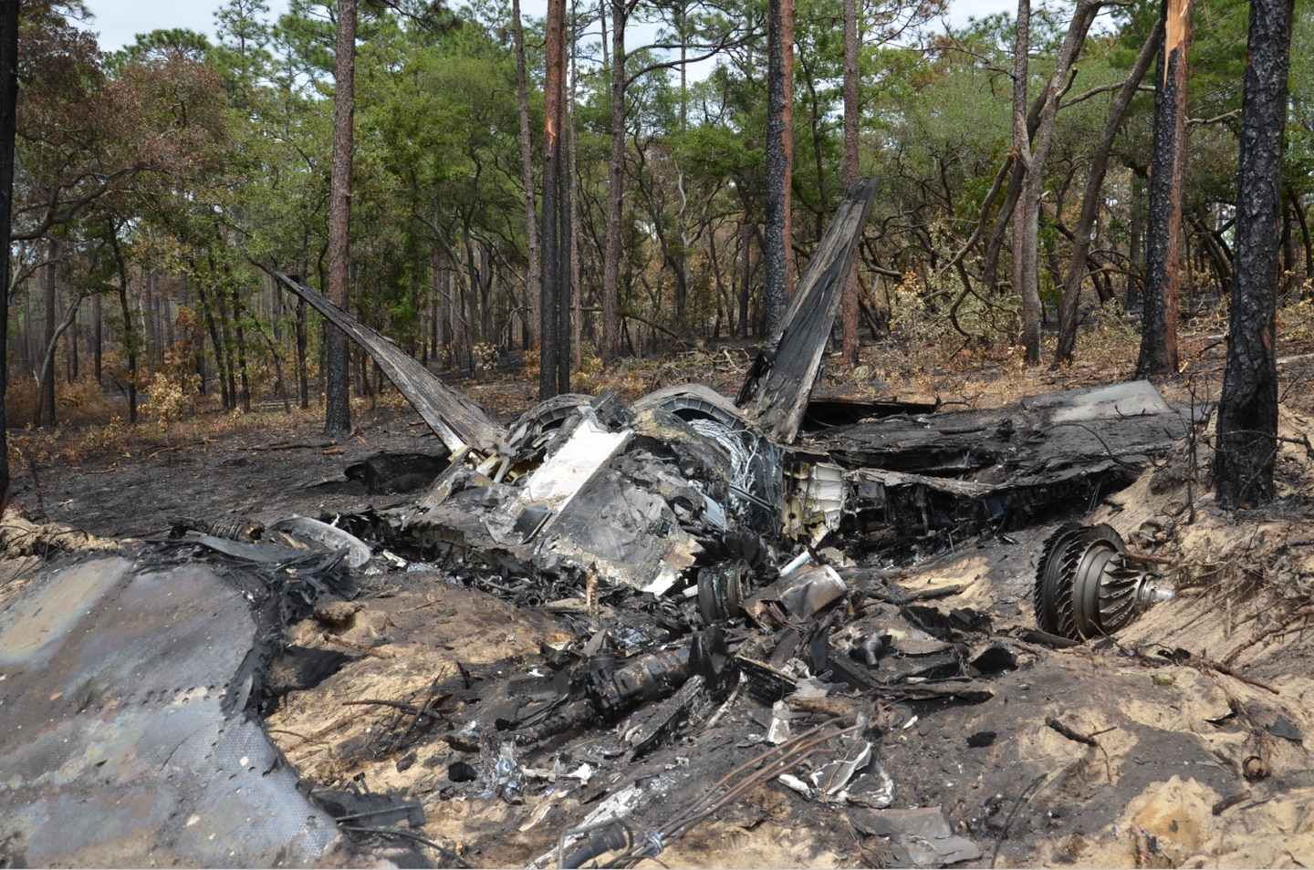 Photos of the wreckage of an F-22 Raptor fighter jet that crashed on May 15, 2020, were included in an Air Force investigation report obtained by Air Force Times via the Freedom of Information Act. (Air Force)