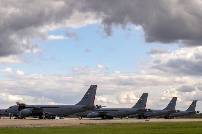 Members of the 121st Air Refueling Wing Maintenance Squadron perform an inspection on a KC-135 Stratotanker at Rickenbacker Air National Guard Base, Columbus, Ohio, Oct. 16, 2021. (Staff Sgt. Wendy Kuhn/Air National Guard)
