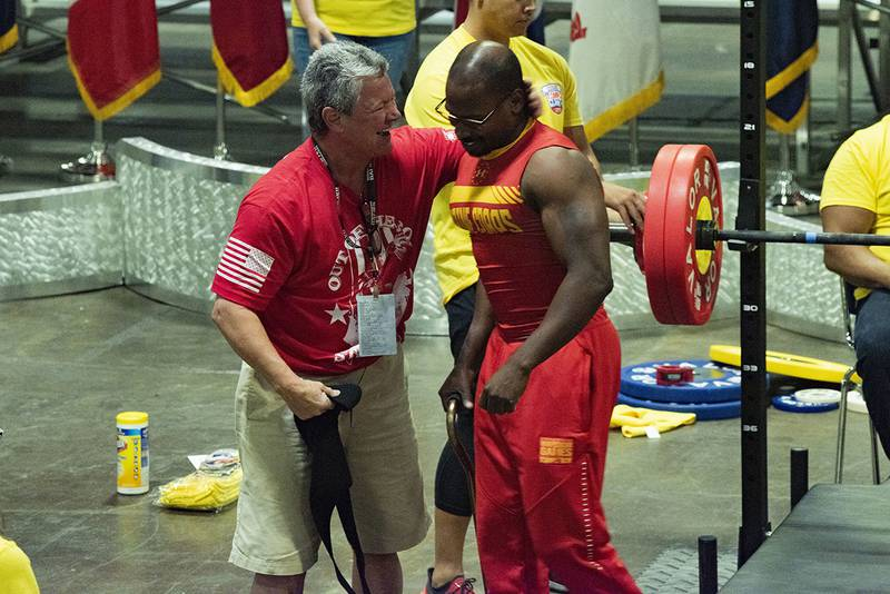Marine Corps competitor Sgt. Durrell Jones celebrates with his coach after a successful lift during the powerlifting competition at the DoD Warrior Games in Tampa, Fla.