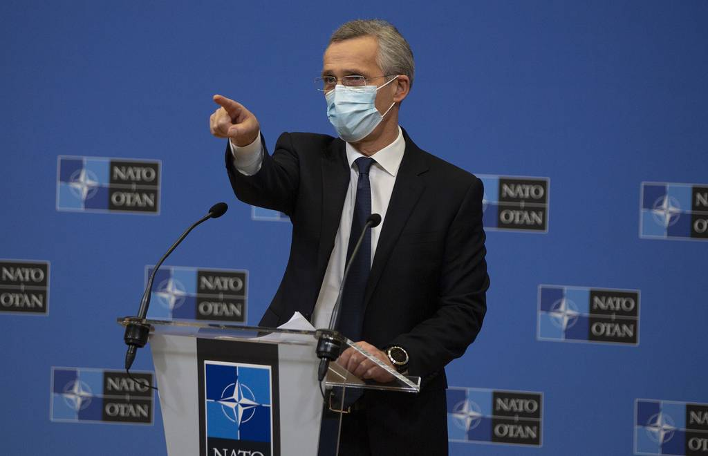 NATO Secretary General Jens Stoltenberg wears a protective face mask as he prepares to speak during a media conference at NATO headquarters in Brussels on Thursday, Feb. 18, 2021.