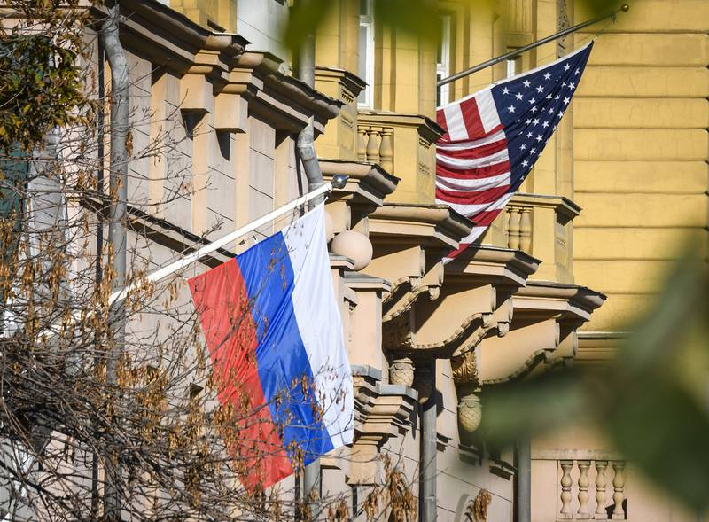 A Russian flag flies next to the US Embassy building in Moscow on Oct. 22, 2018.