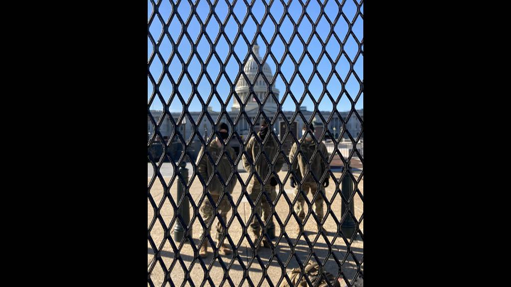 National Guard troops stand watch at the Capitol in the wake of the deadly Jan. 6 riot by supporters of Donald Trump.