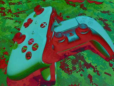 Xbox and Playstation controllers sit atop a Marine Corps camouflage blouse.