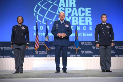 Chief of Space Operations Gen. John Raymond, center, introduces the new Space Force uniform prototypes at the Air Force Association's 2021 Air, Space & Cyber Conference on September 21. (Mike Tsukamoto/Air Force Magazine)