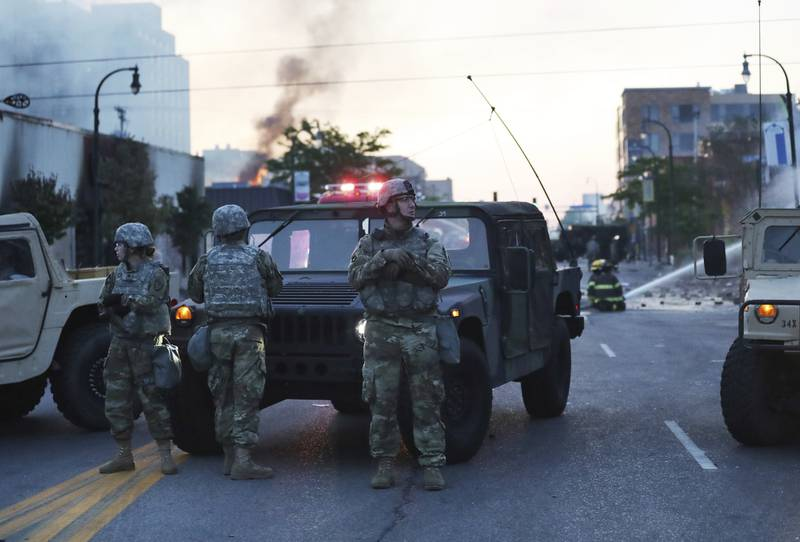 Minnesota National Guard members maintain a position protecting nearby firefighters in the wake of the death of George Floyd while in police custody earlier in the week and seen Saturday, May 30, 2020, in Minneapolis.