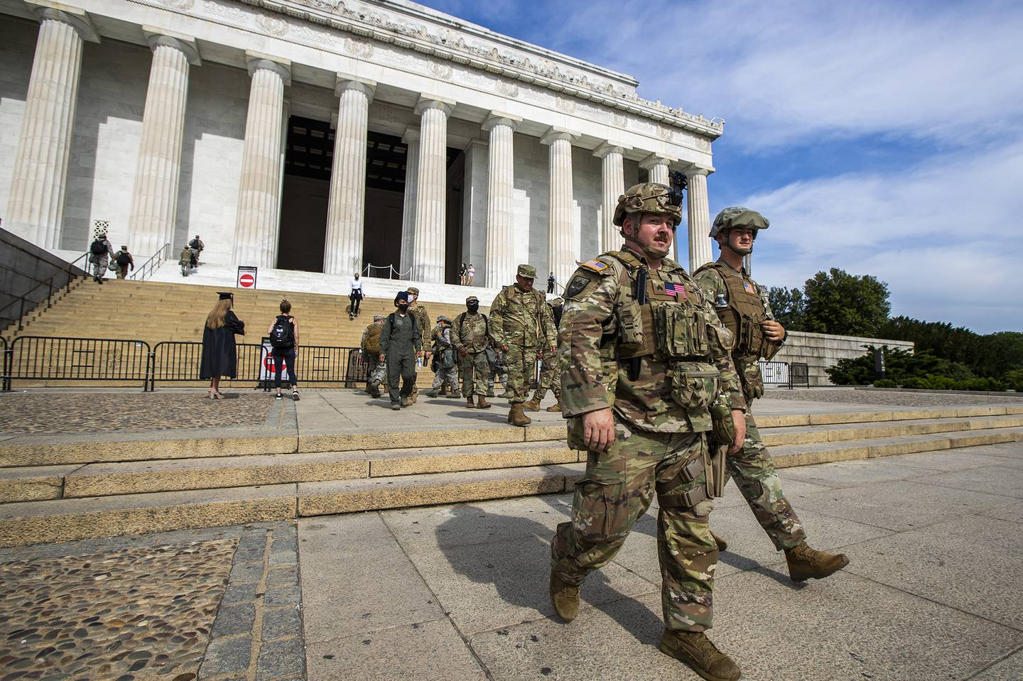 Members of the District of Columbia Army National Guard walk to their designated positions at the National Mall near the Lincoln Memorial in Washington, Wednesday, June 3, 2020, securing the area as protests continue following the death of George Floyd, a who died after being restrained by Minneapolis police officers.