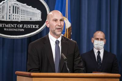 Steven D'Antuono, head of the FBI Washington field office, speaks as acting U.S. Attorney Michael Sherwin, right, listens during a news conference Tuesday, Jan. 12, 2021, in Washington.
