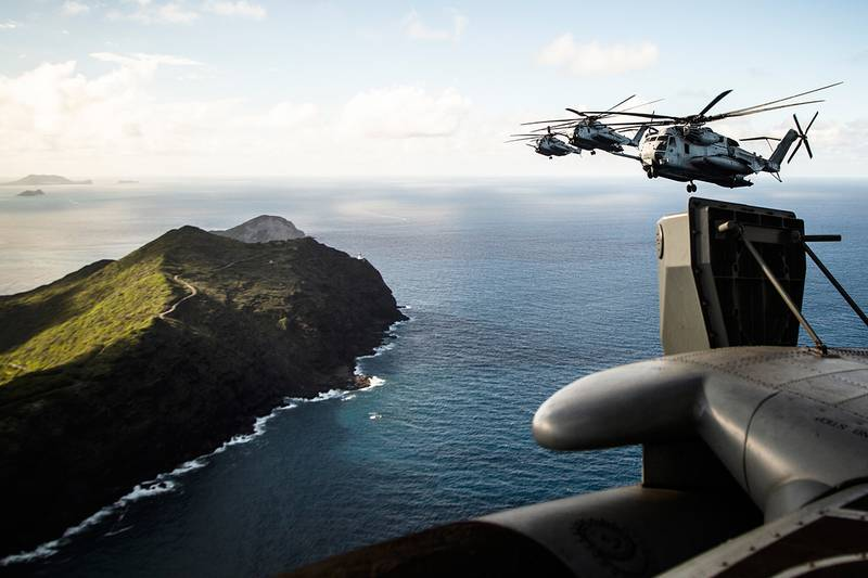 Marines fly near the shores of Kalaeuila in CH-53E Super Stallion helicopters over the Island of Oahu, Hawaii, on July 3, 2019.