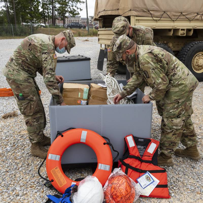 Mississippi Army National Guard Soldiers assigned to an engineer composite team pack supplies in preparation to conduct high-water rescues in response to Hurricane Sally at Camp Shelby Joint Force Training Center, Miss., Sept. 15, 2020. The Mississippi National Guard is prepared to conduct civil support operations, including search and rescue and debris removal, to support local and state authorities. (U.S. Army National Guard photo by Cdt. Jarvis Mace)