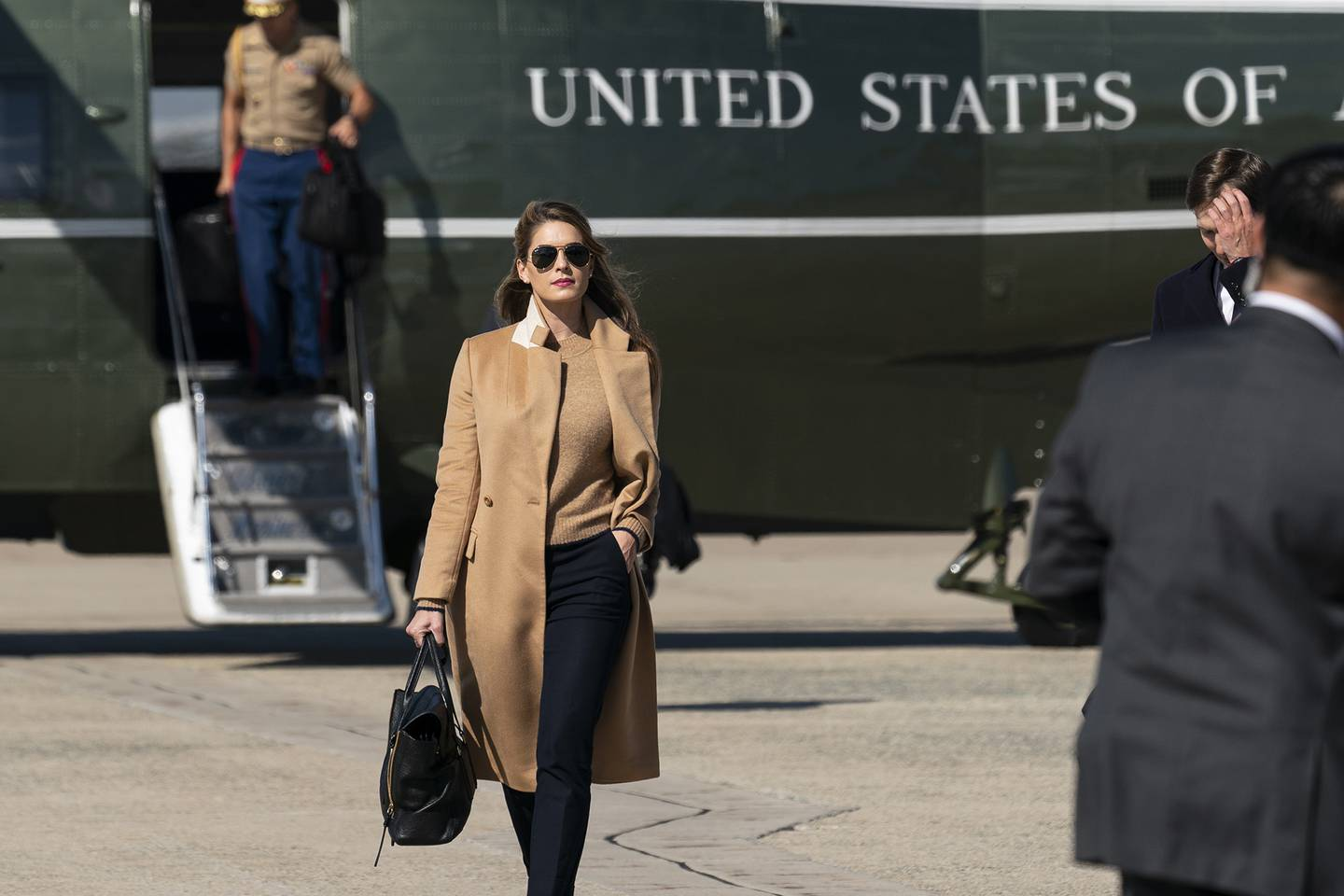 Counselor to the President Hope Hicks walks from Marine One to accompany President Donald Trump aboard Air Force One as he departs Wednesday, Sept. 30, 2020, at Andrews Air Force Base, Md.