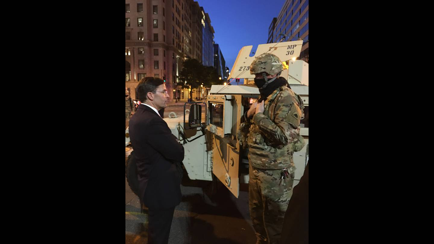 Defense Secretary Mark Esper greets D.C. National Guard troops hours after visiting St. John's Episcopal Church with President Donald Trump, Chairman of the Joint Chiefs of Staff Army Gen. Mark Milley and other leaders.