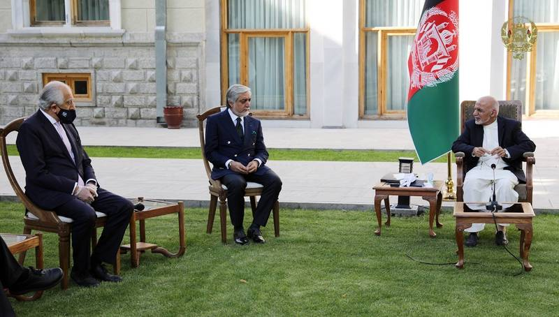 In this Wednesday, May 20, 2020, photo, Afghan President Ashraf Ghani, right, and fellow leader under a recently signed power-sharing agreement, Abdullah Abdullah, center, hold a meeting with U.S. peace envoy Zalmay Khalilzad aimed at resuscitating a U.S.-Taliban peace deal signed in February, at the Presidential Palace, in Kabul, Afghanistan.
