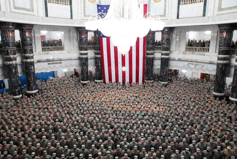 1,215 U.S. service members from all over Iraq re-enlisted during a ceremony in the Al Faw Palace rotunda at Camp Victory in Baghdad, July 4, 2008.