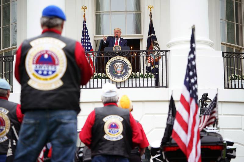 """President Donald Trump speaks during the """"Rolling to Remember Ceremony: Honoring Our Nations Veterans and POW/MIA"""" on May 22, 2020, from the Truman Balcony at the White House in Washington."""