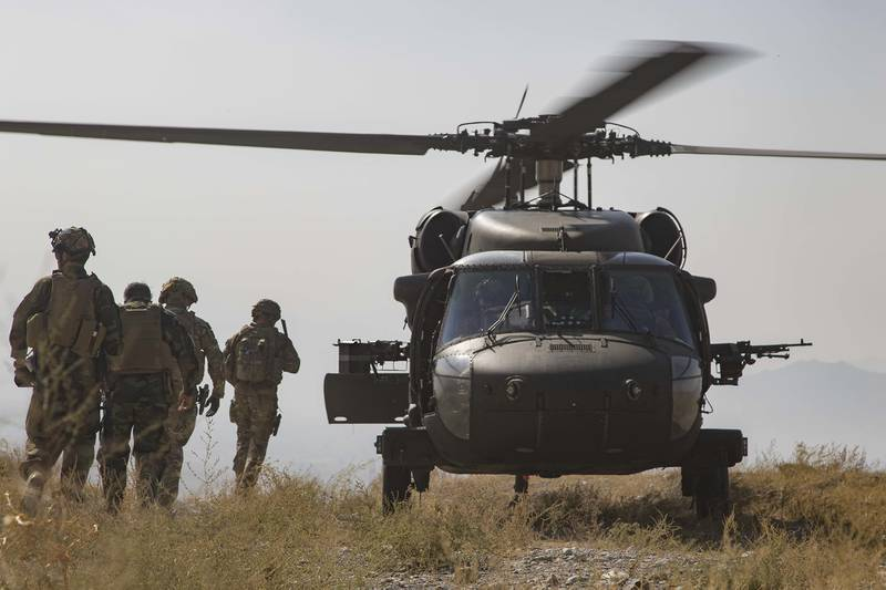 Afghan National Army soldiers and coalition advisers assigned prepare to board a UH-60 Black Hawk helicopter following the completion of a key stage of an Afghan-led and executed clearance operation to safeguard Afghan civilians in southeastern Afghanistan, Sept 25, 2019.