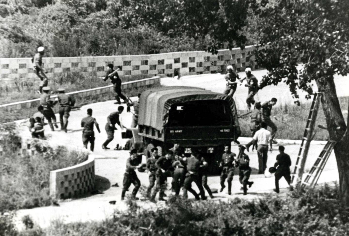 In this Aug. 18, 1976, file photo, North Korean soldiers attack United Nations Command personnel wearing helmets at the truce village of Panmunjom, South Korea.