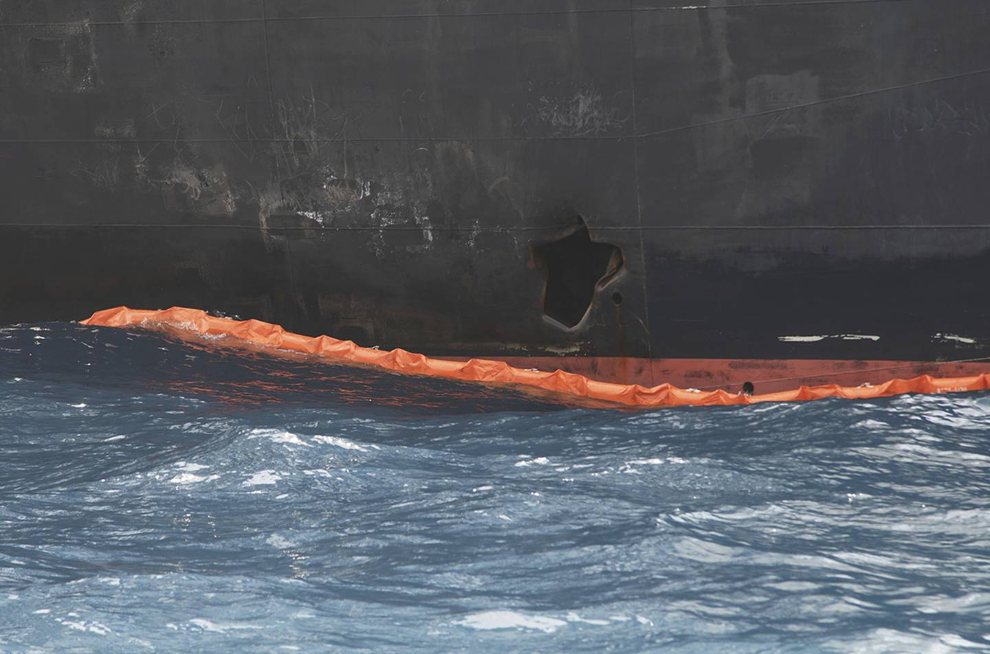 A hole the U.S. Navy says was made by a limpet mine is seen on the damaged Panama-flagged, Japanese owned oil tanker Kokuka Courageous