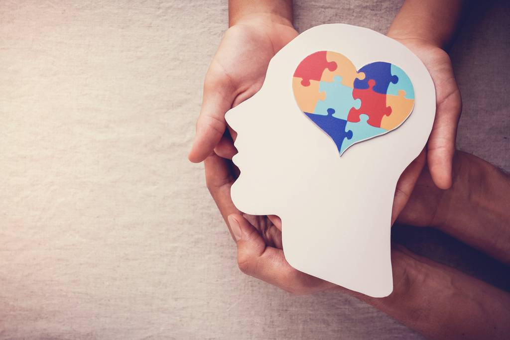 puzzle jigsaw heart on brain,  mental health concept, world autism awareness day