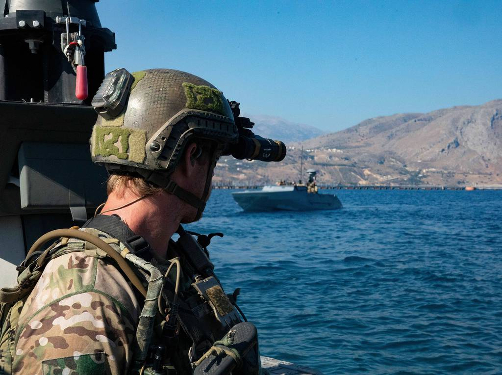 U.S. Naval Special Warfare operators and U.S. Navy Special Warfare combatant-craft crewmen prepare for a visit, board, search, and seizure exercise during a training mission at the NATO Maritime Interdiction Operational Training Center, Greece on July 31, 2020.