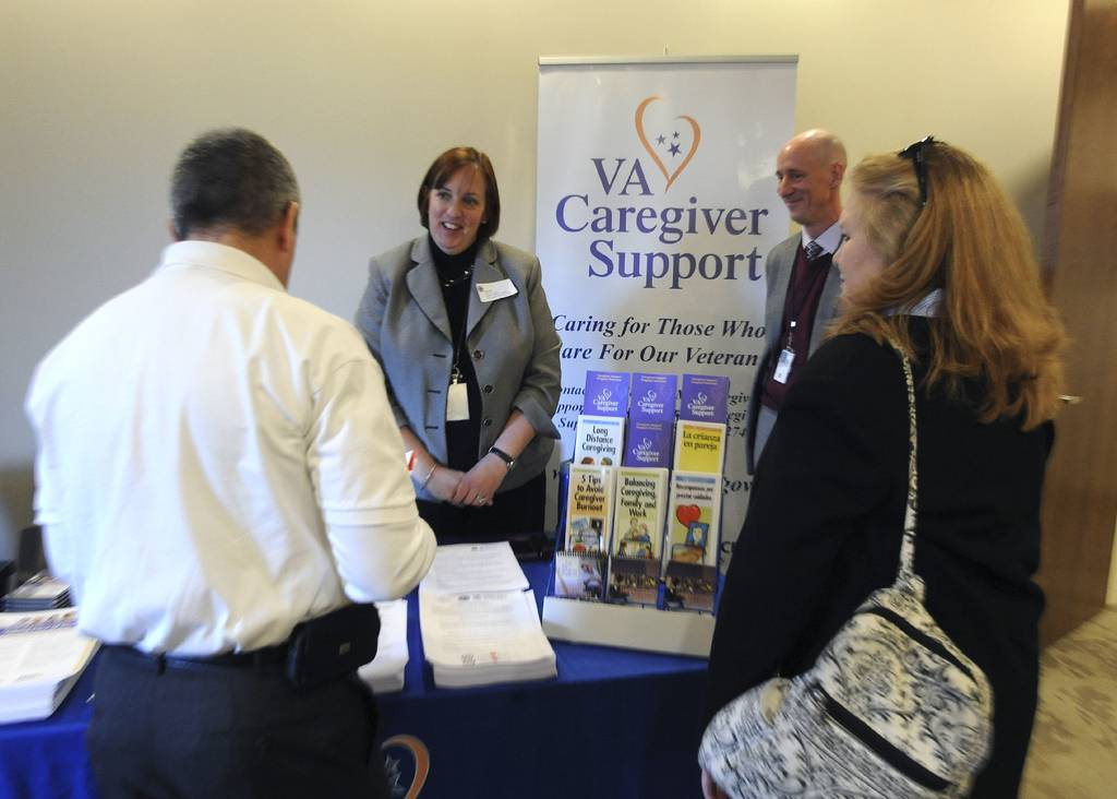 Veterans and veteran organizations learn about the services available from the VA at the VA Services Showcase in Arlington, Va., in 2014