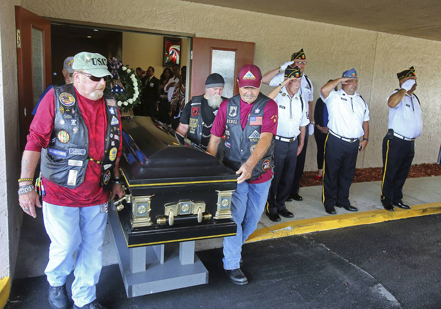 Motorcyclists from VFW Post 4287 and American Legion Post 155 present the casket of Stephen Jerald Spicer, a homeless U.S. Army veteran, during a full military honors service at Woodlawn Memorial Park in Gotha, Fla., July 18, 2019.