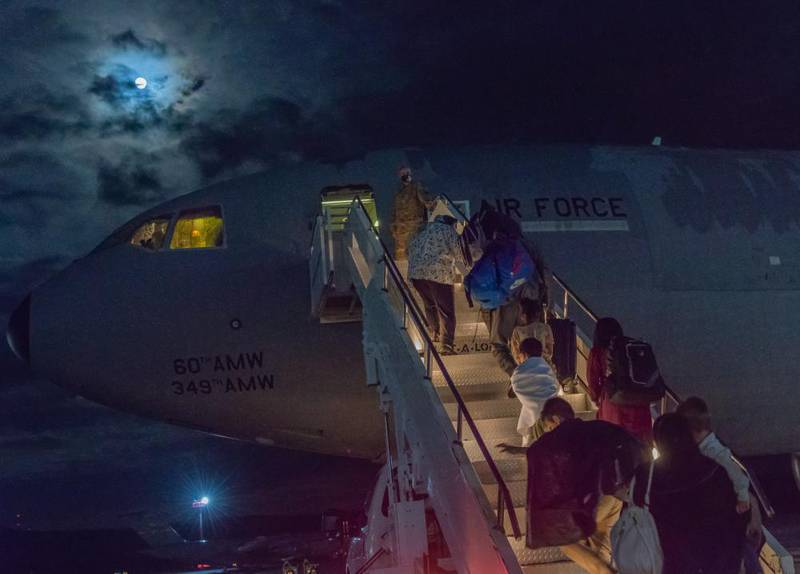 Just after midnight on Aug. 23, 2021, the first group of evacuees from Afghanistan who stayed at Ramstein Air Base, Germany, left for the United States on a military transport jet. (Air Force photo via Facebook)