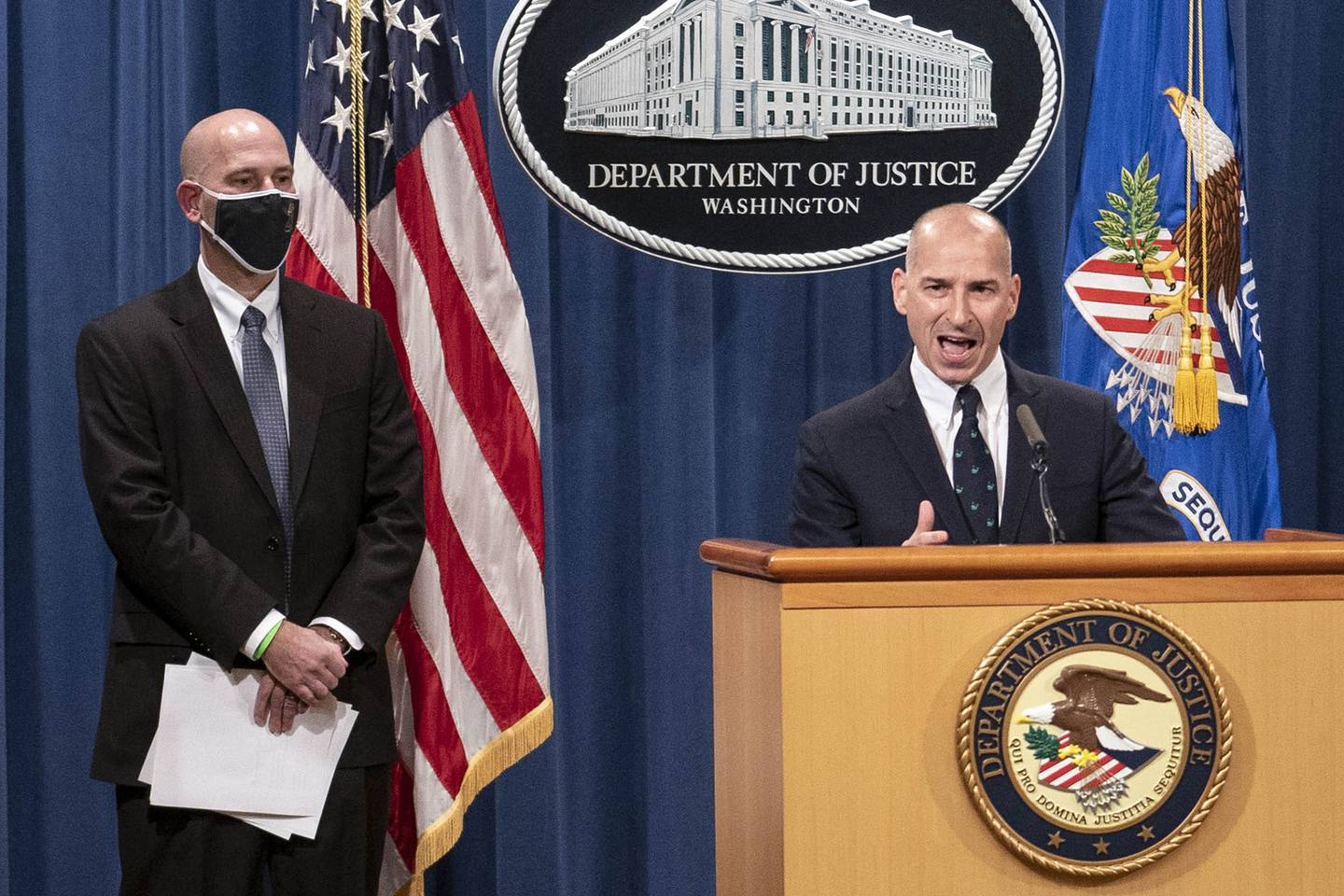 Steven D'Antuono, head of the FBI Washington field office, left, listens as acting U.S. Attorney Michael Sherwin, speaks during a news conference Tuesday, Jan. 12, 2021, in Washington.