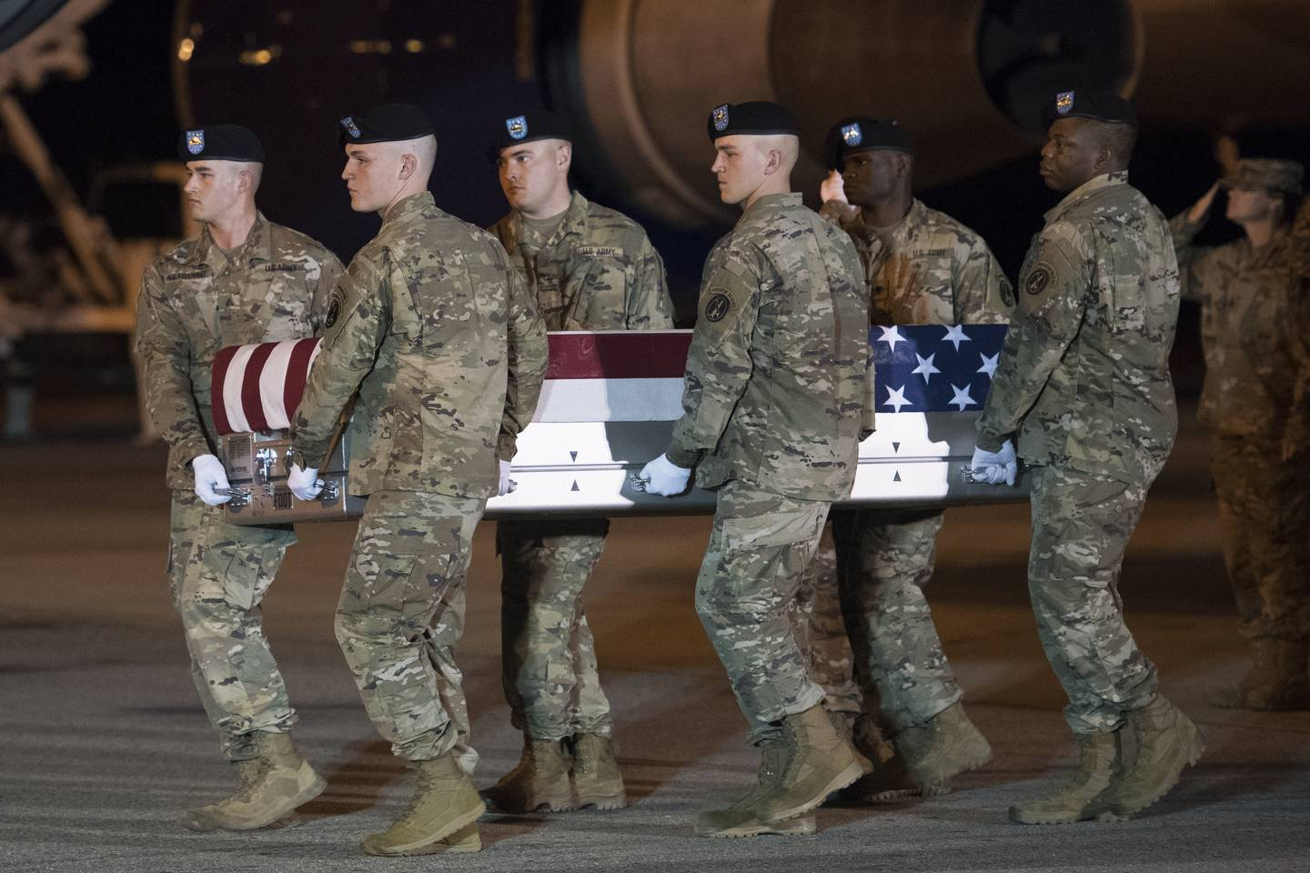 An Army carry team moves a transfer case containing the remains of Sgt. 1st Class Elis Barreto Ortiz, 34, from Morovis, Puerto Rico, Saturday, Sept. 7, 2019, at Dover Air Force Base, Del.