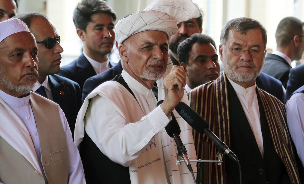 Afghanistan's President Ashraf Ghani, center, speaks after offering Eid al-Adha prayers at the presidential palace in Kabul, Afghanistan, Sunday, Aug. 11, 2019.