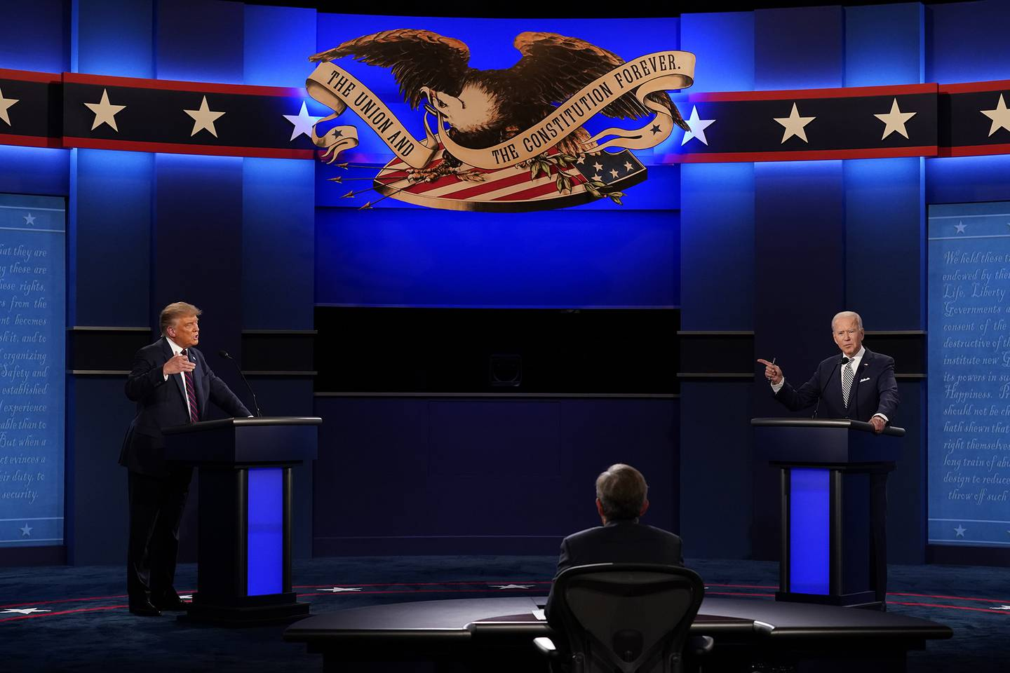 President Donald Trump, left, and Democratic presidential candidate former Vice President Joe Biden, right, with moderator Chris Wallace, center, of Fox News during the first presidential debate Tuesday, Sept. 29, 2020, at Case Western University and Cleveland Clinic, in Cleveland.