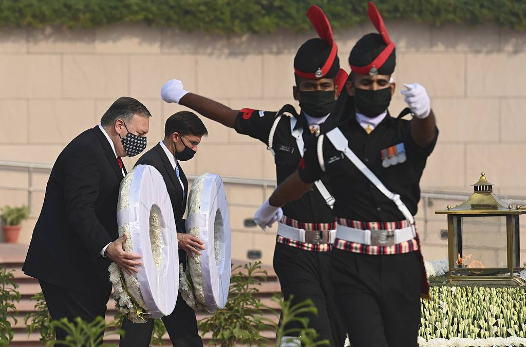 U.S. Secretary of State Mike Pompeo, left, and Secretary of Defense Mark Esper pay their tributes at the National War Memorial in New Delhi, India, Tuesday, Oct. 27, 2020.
