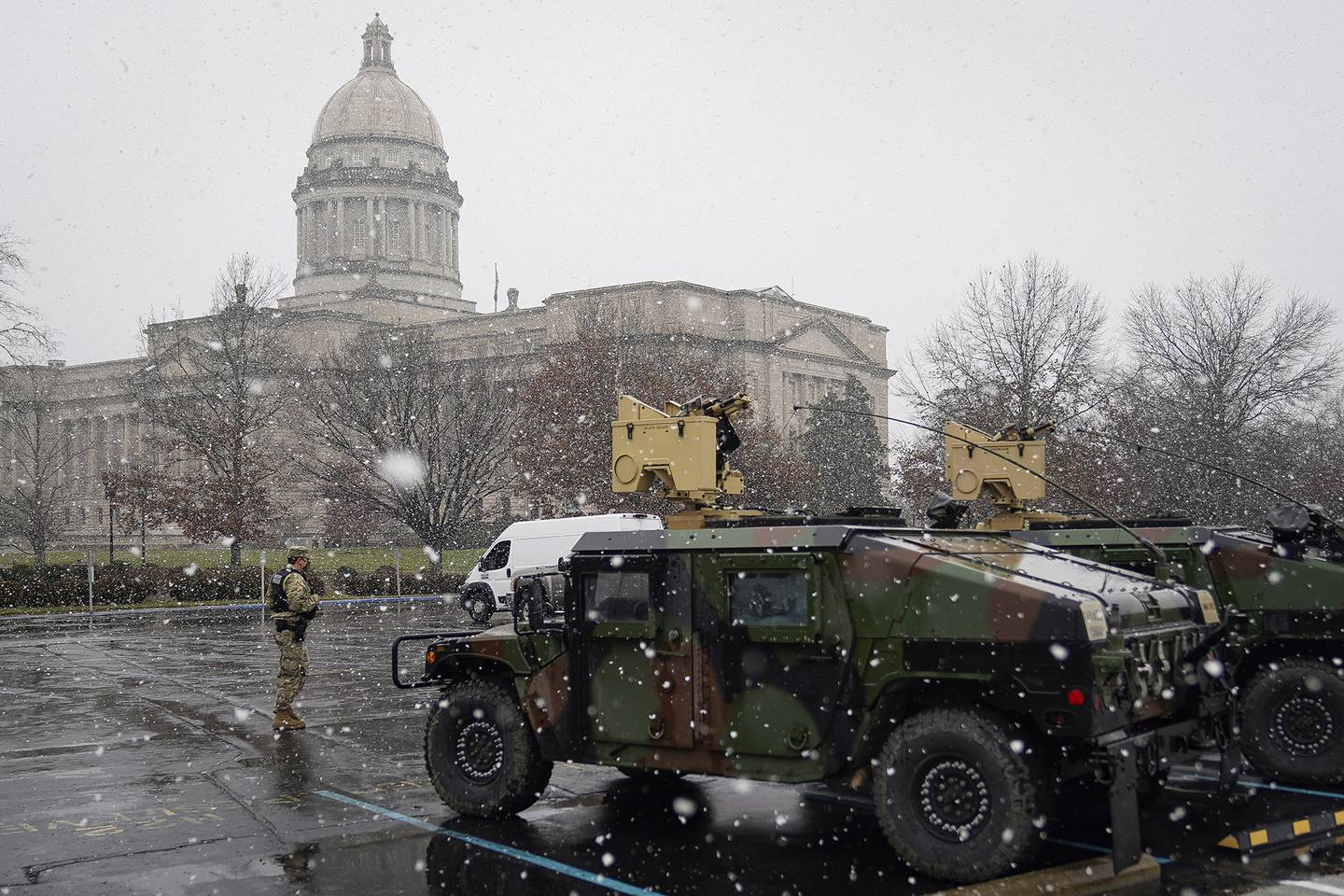A National Guard soldier stands outside the Capitol building in Frankfort, Ky., Sunday, Jan. 17, 2021.