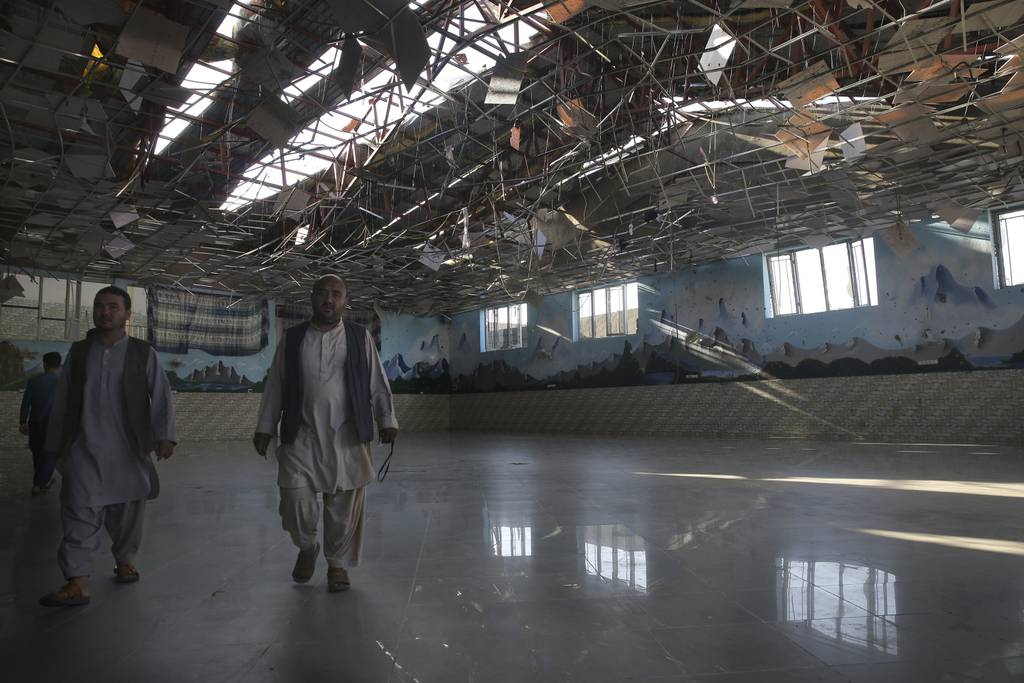 The damage of Dubai City wedding hall is seen after an explosion in Kabul, Afghanistan, Sunday, Aug.18,  2019.