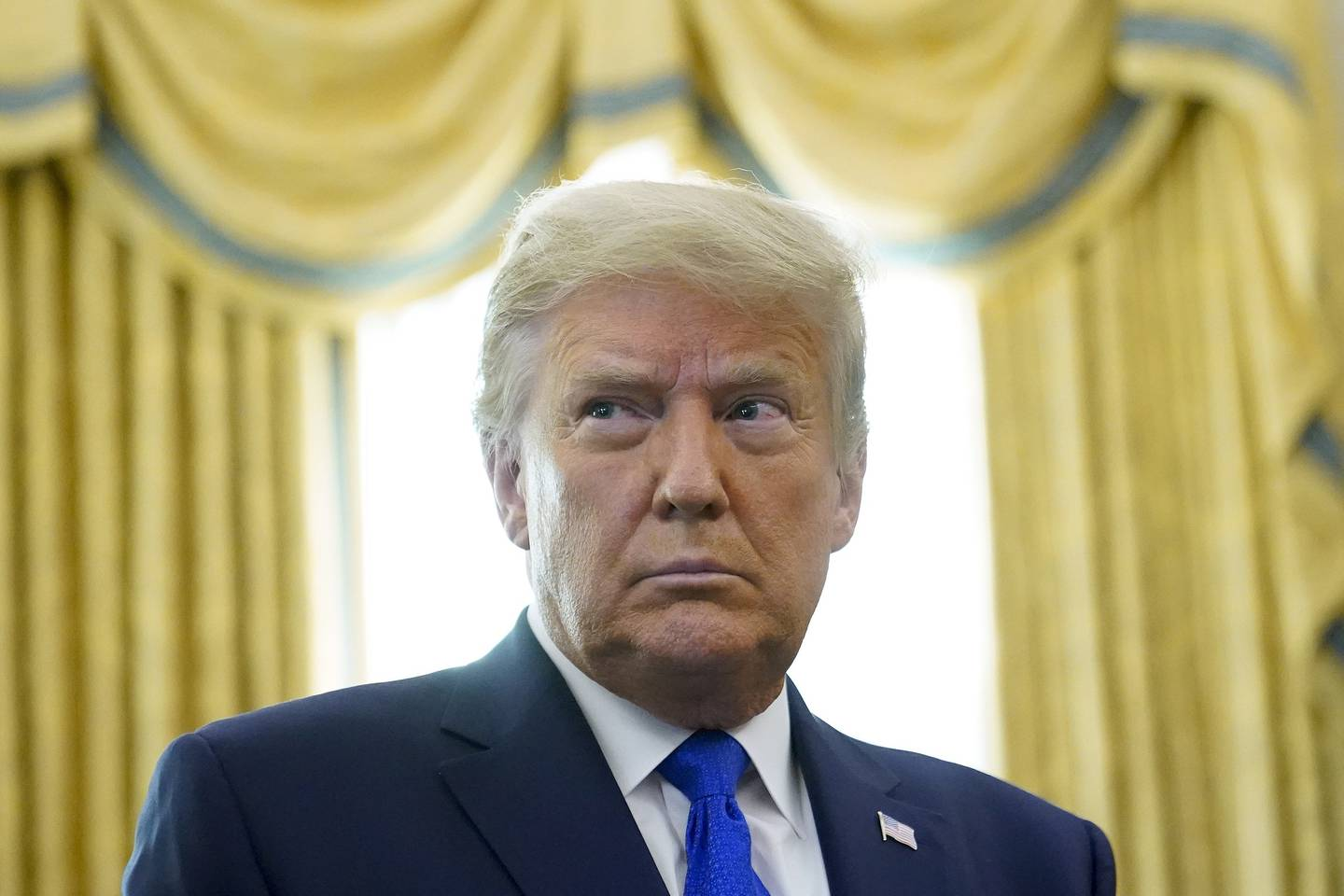 In this Dec. 7, 2020, photo,President Donald Trump in the Oval Office of the White House in Washington.