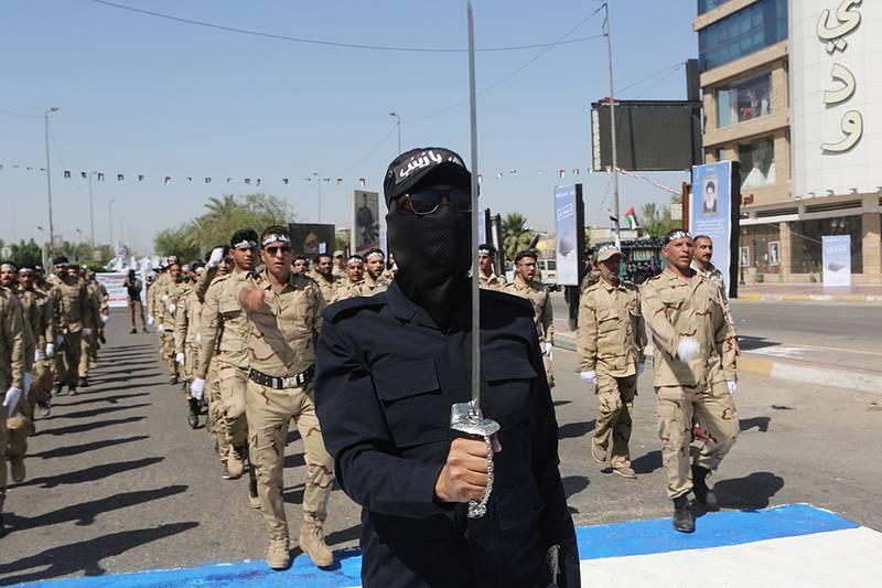 Iraqi Popular Mobilization Forces march in Baghdad, Iraq.