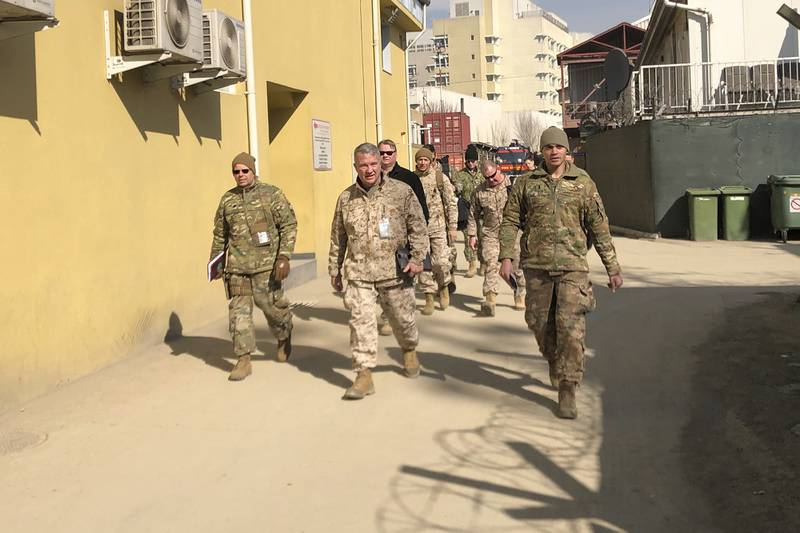 Marine Gen. Frank McKenzie, center, the top U.S. commander for the Middle East, makes an unannounced visit Jan. 31, 2020 in Kabul, Afghanistan.