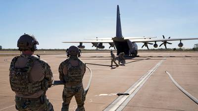 Forward Area Refueling Point specialists align fuel hosing between a U.S. MC-130J Air Commando II and an Australian C-130J Hercules during Talisman Sabre 21 at Royal Australian Air Force Base Tindal in Australia's Northern Territory on July 22, 2021. This was the first time an Australian aircraft was refueled by a U.S. aircraft via a FARP. Australian and U.S. Forces combine biennially for Talisman Sabre; a month-long multi-domain exercise that strengthens allied and partner capabilities to respond to the full range of Indo-Pacific security concerns. (1st Lt. Joshua Thompson/Air Force)