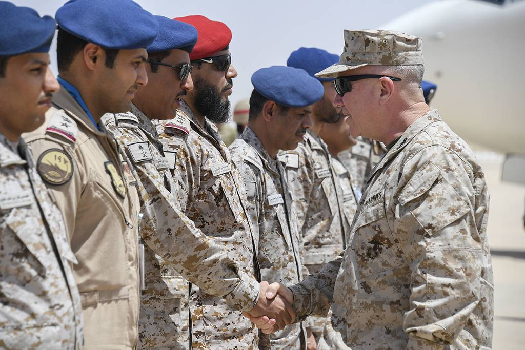 Marine Corps Gen. Kenneth F. McKenzie Jr., the commander of U.S. Central Command, right, shakes hands with airmen of the Royal Saudi Air Force on Prince Sultan Air Base, July 18, 2019.
