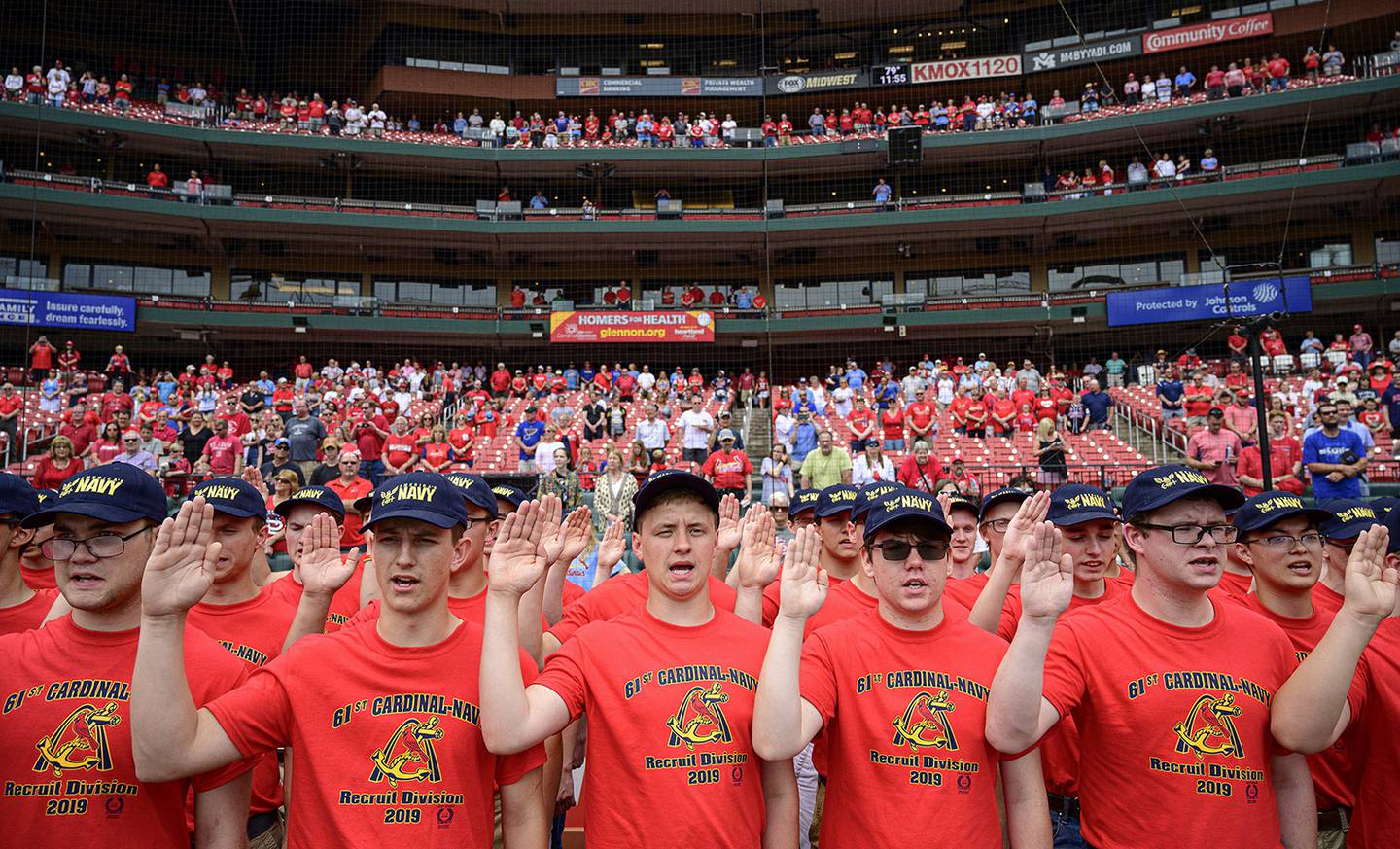 Eighty-one recruits with the 61st Annual Recruit Cardinal Division recite the oath of enlistment at Busch Stadium during a pre-game ceremony, June 6, 2019, in St. Louis.