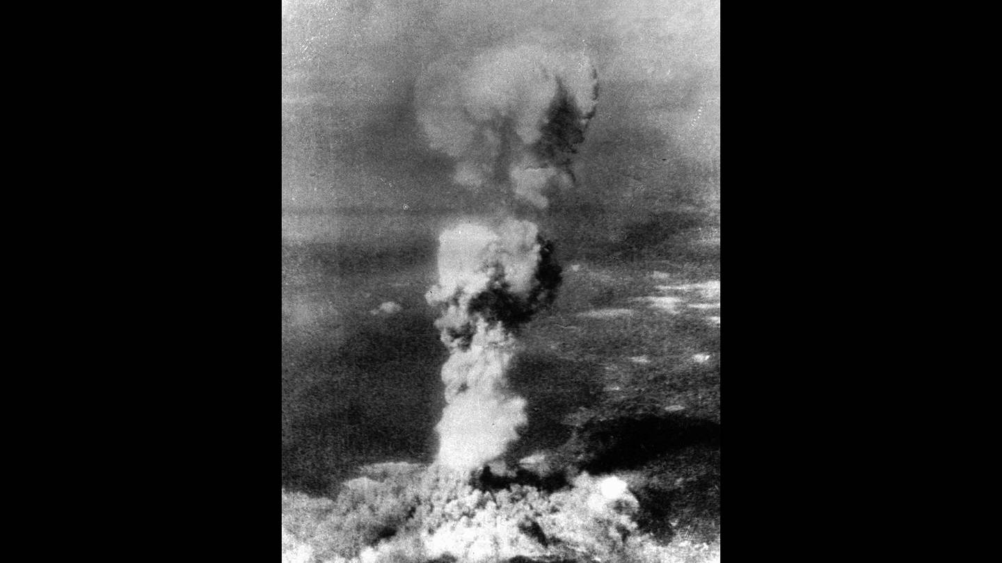 """In this Aug. 6, 1945, file photo released by U.S. Air Force, a column of smoke rises 20,000 feet over Hiroshima, Japan, after the first atomic 5-ton """"Little Boy"""" bomb was released."""
