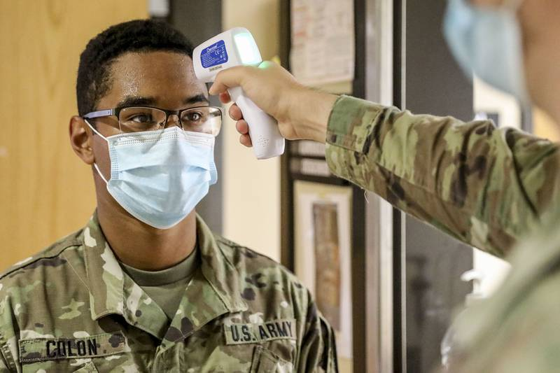 A soldier has his temperature taken during screenings for COVID-19 at Fort Hood, Texas, July 13, 2020.