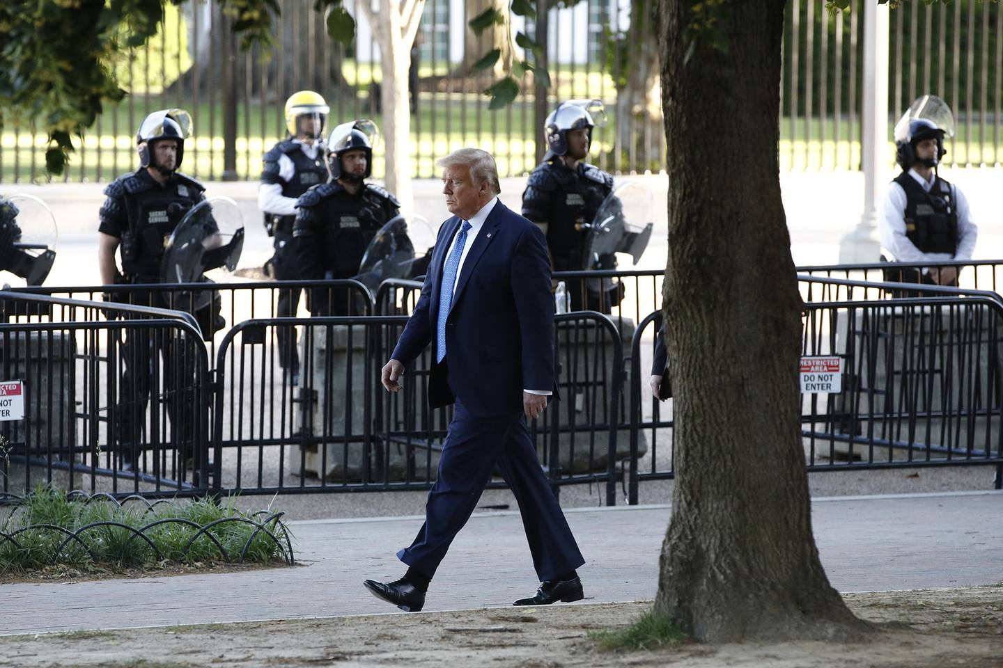 President Donald Trump walks in Lafayette Park to visit outside St. John's Church across from the White House Monday, June 1, 2020, in Washington. Part of the church was set on fire during protests on Sunday night.