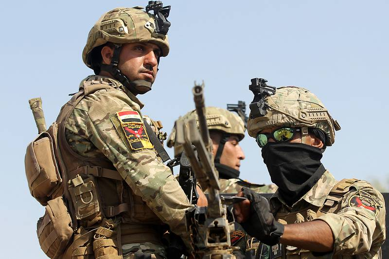 Iraqs rapid response forces storm a house in the Tarmiyah district, north of Baghdad, searching for wanted Islamic State group suspects on July 21, 2019.