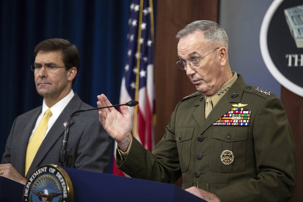 Joint Chiefs Chairman Gen. Joseph Dunford with Secretary of Defense Mark Esper speaks to reporters during a briefing at the Pentagon, Wednesday, Aug. 28, 2019.