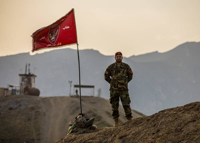 Afghan National Army soldier stand on top of a hill during a visit by Afghan Deputy Defense Minister Dr. Yasin Zia and Resolute Support Commander Gen. Scott Miller in Kabul, Afghanistan, March 3, 2020.