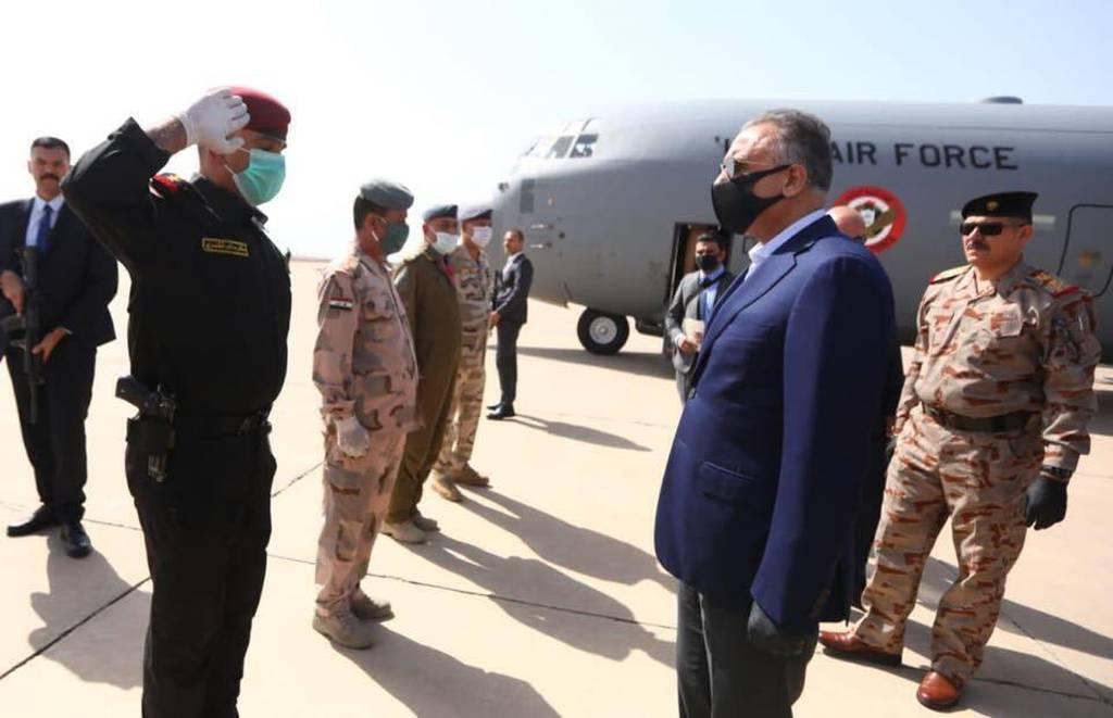 Iraqi Prime Minister Mustafa al-Kahdimi, right, arrives to Mosul, Iraq, Wednesday, June 10, 2020.